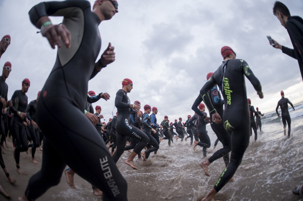 Triathletes begin the swimming portion in the Ironman triathlon in Marina D'Or Spain
